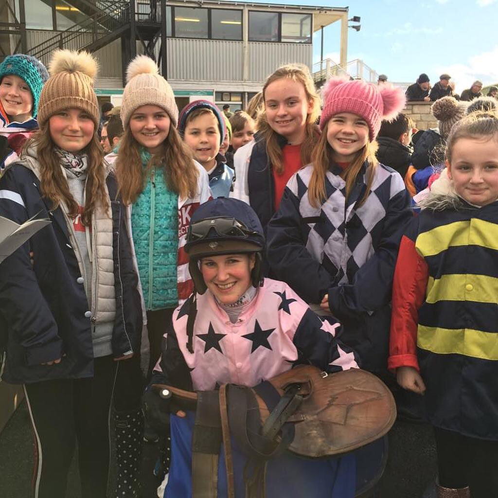 Winning jockey Lucy Alexander pictured with students