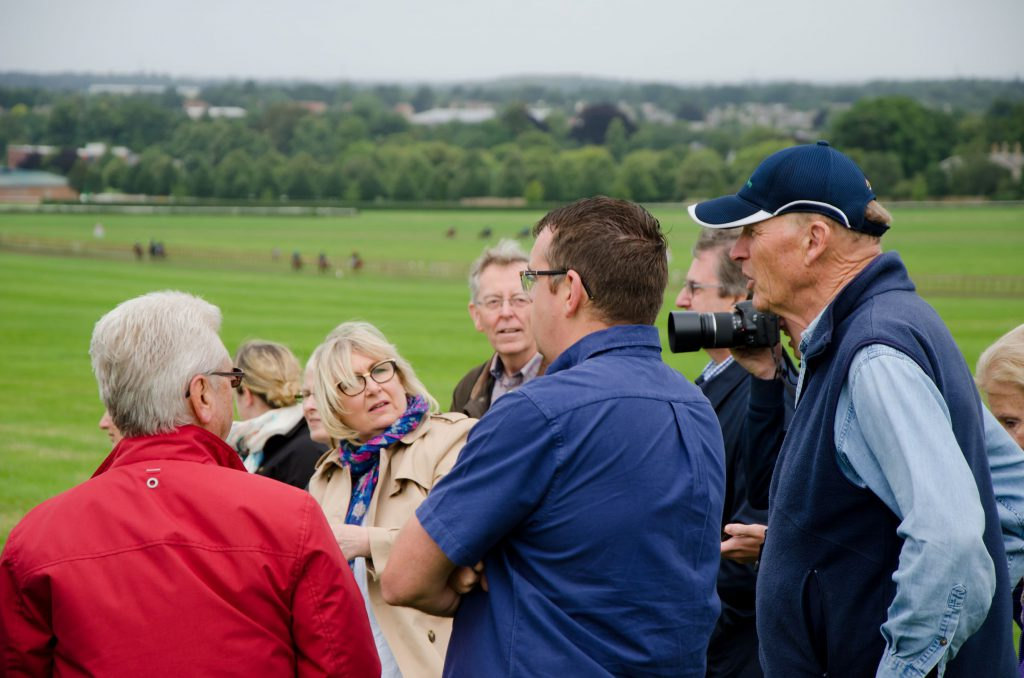 John Gosden with a Discover Newmarket tour group on Warren Hill