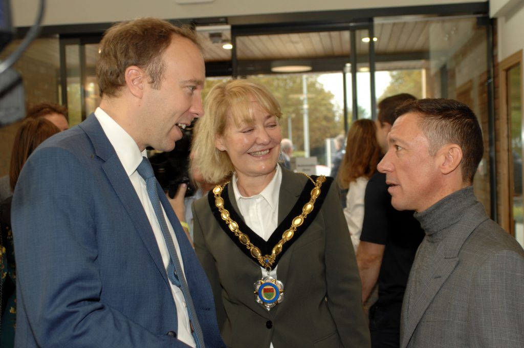 Matt Hancock, Secretary of State for Health and Social Care and MP for West Suffolk speaking with Newmarket Mayor Rachel Hood and Frankie Dettori