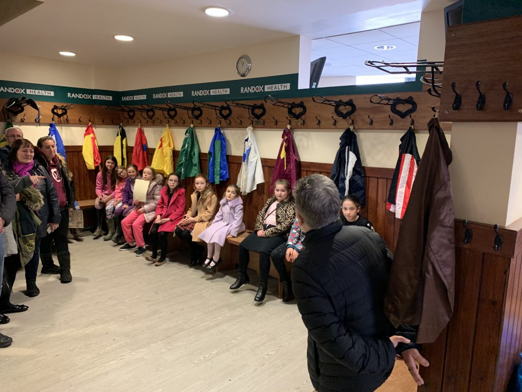 Children from Park Palace Ponies going behind the scenes in Aintree's weighing room